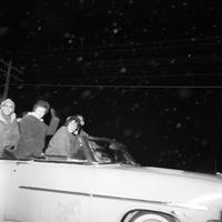 Students Riding in the Torch Light Parade