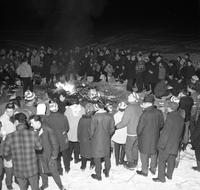 Gathering Around Bonfire